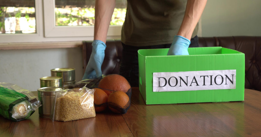 Image showing food being put in donation box